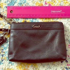Black Coach punched leather wristlet